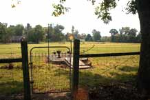 Pasture gate to storm shelter